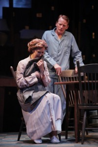 Annie Fitzpatrick as Linda Loman cradles her husband Willy's coat, as son Hap, played by Jared Joplin, looks on